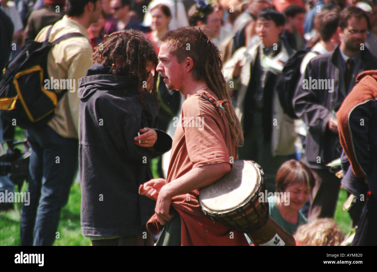 Young man with a drum at the Anti capitalist protest on May Day 2000 in London - Stock Image