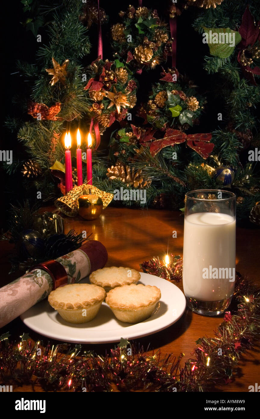 Santa's Treat for supper: Shop bought mince pies with a glass of milk - Stock Image
