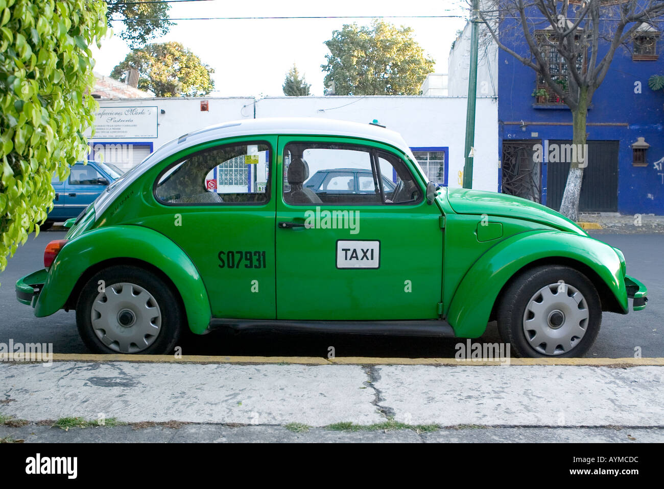Empty Green VW Beetle Taxi parked by the curb in Mexico City Stock Photo