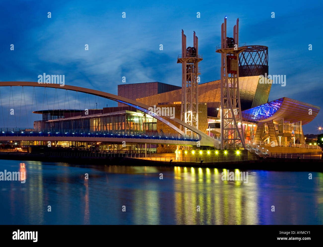 The Lowry Centre and Lowry Outlet Mall at Night, Salford Quays, Greater Manchester, England, UK - Stock Image