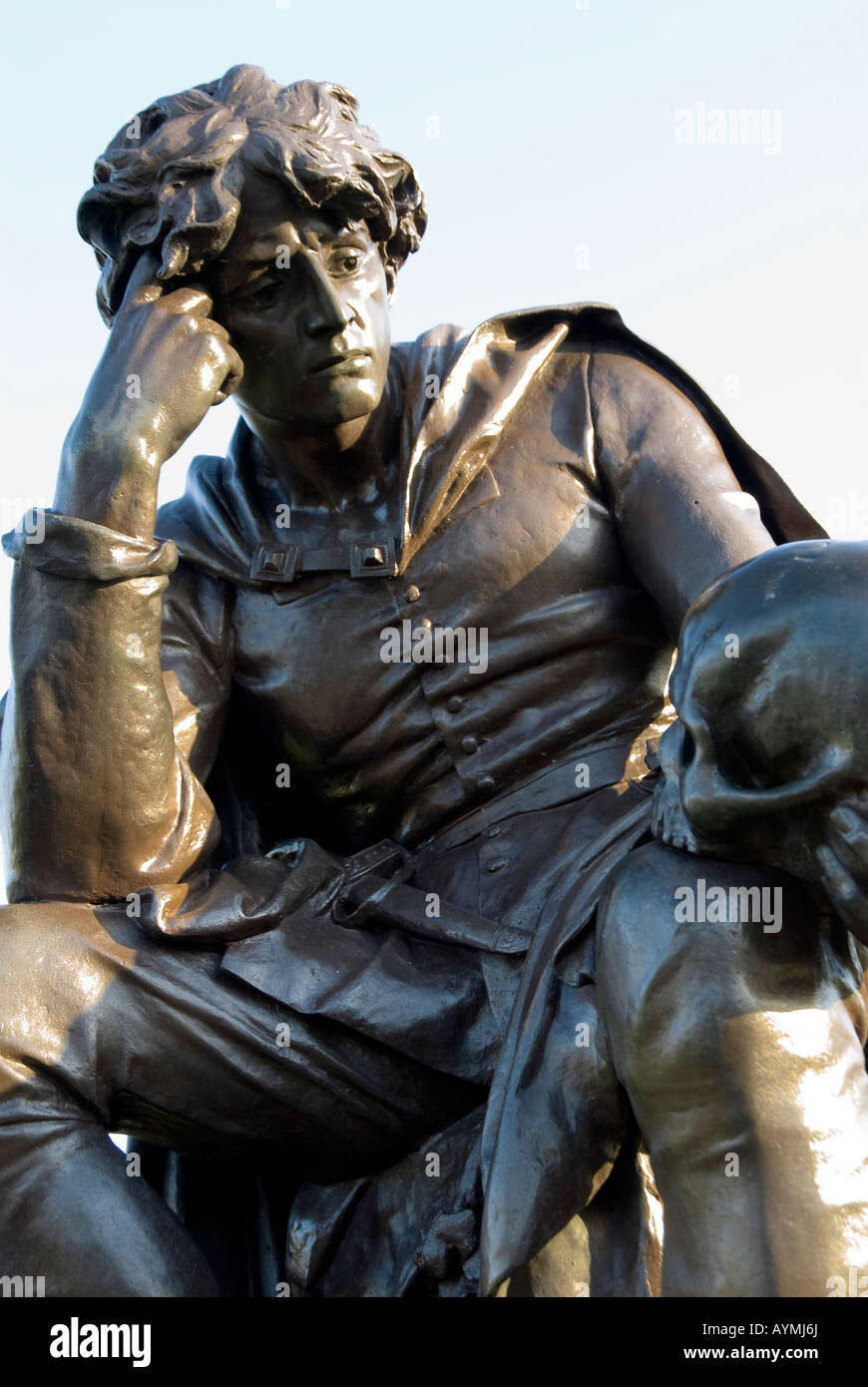 A statue of Hamlet holding the skull of Yorick, at Bancroft Gardens, Stratford upon Avon, Warwickshire, England, - Stock Image