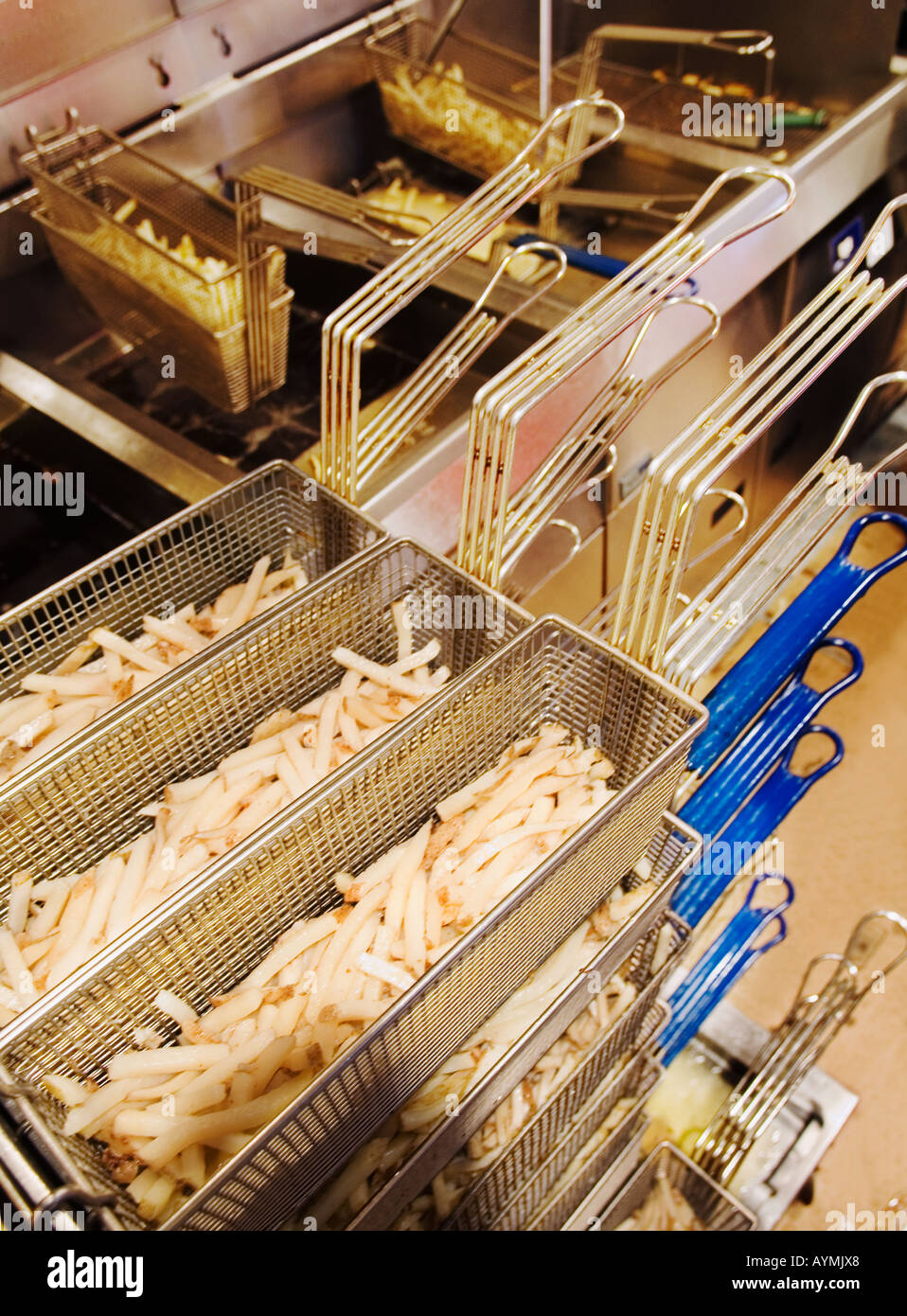 french fries in commercial kitchen - Stock Image