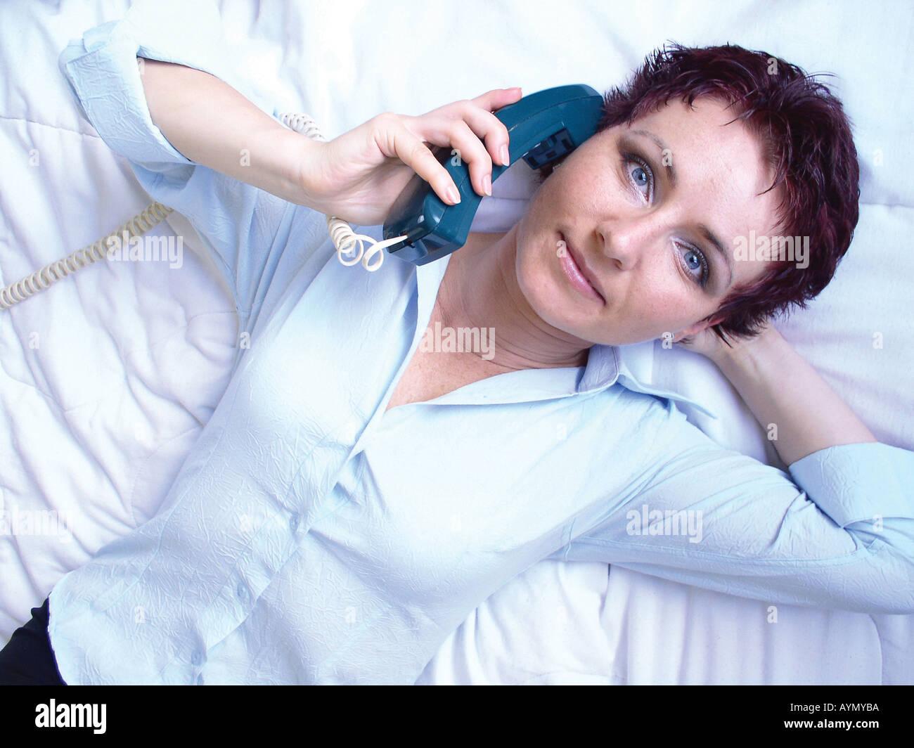 Telefonierende Frau - Stock Image