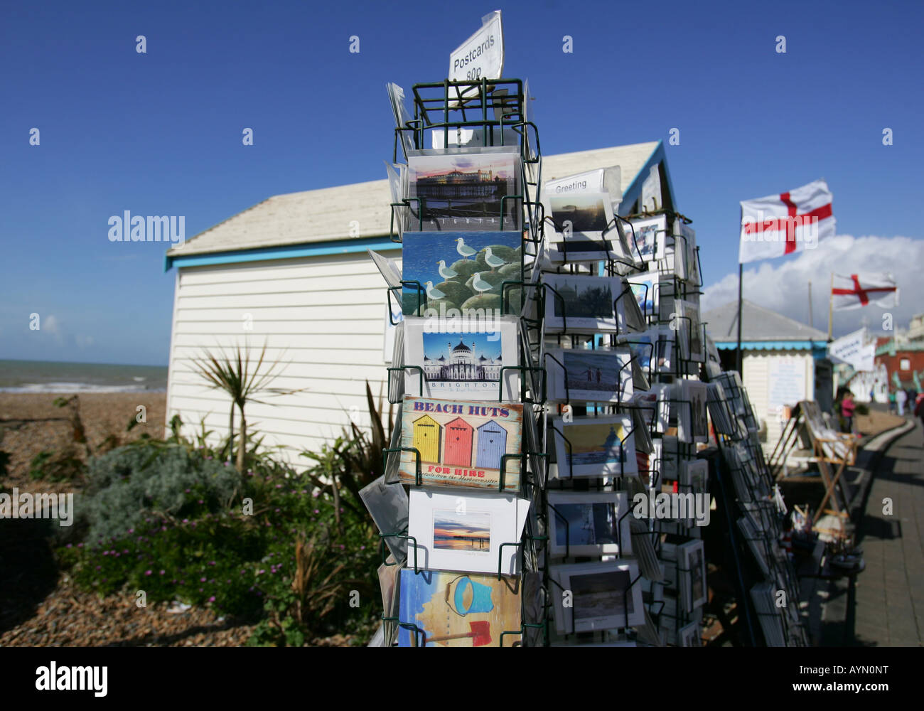 postcards on sale on the seafront in Brighton - Stock Image