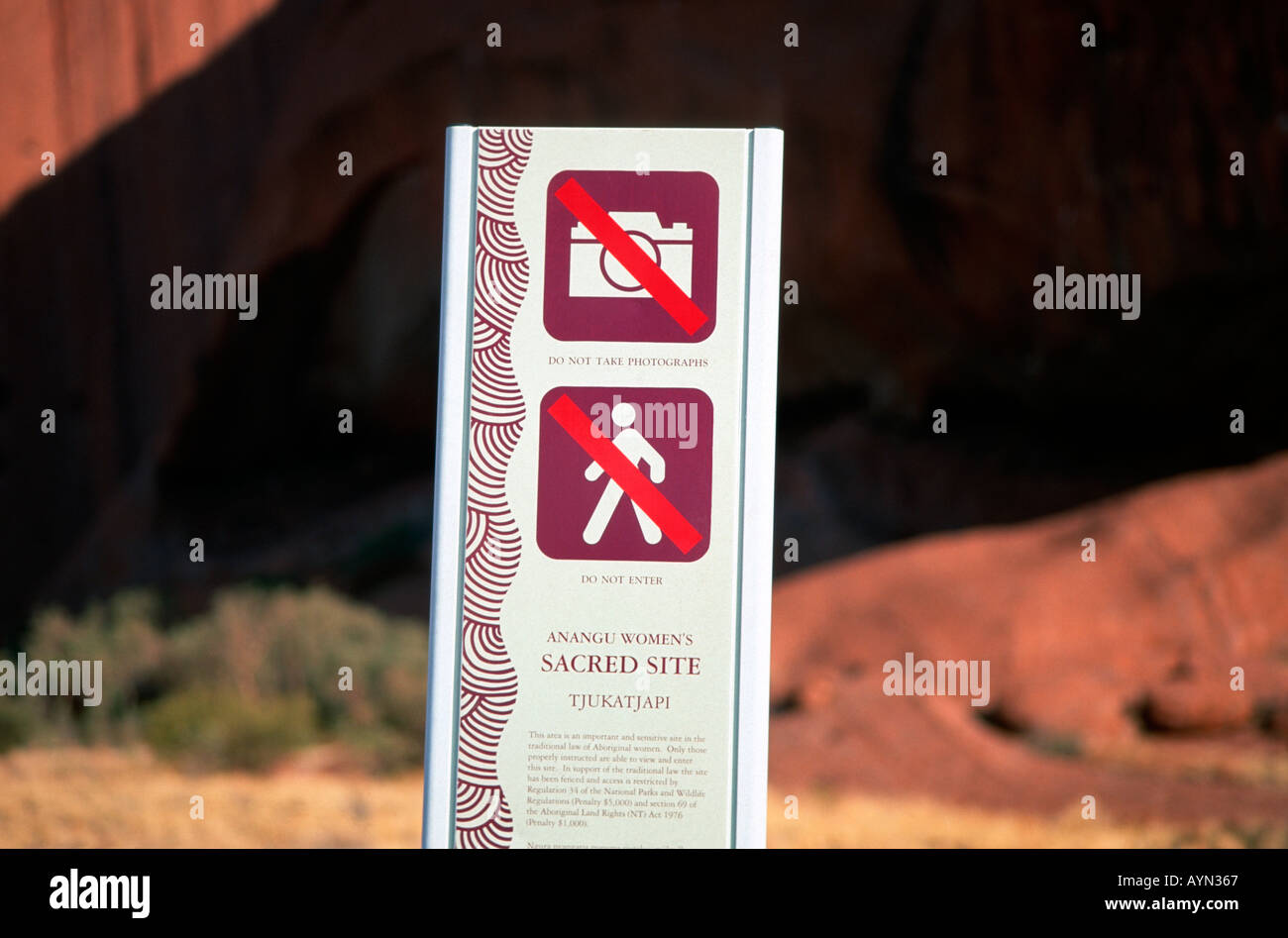 No pictures. Do not take photographs. Anangu women's sacred site Tjukatjapi at the base of Uluru Ayers Rock. - Stock Image