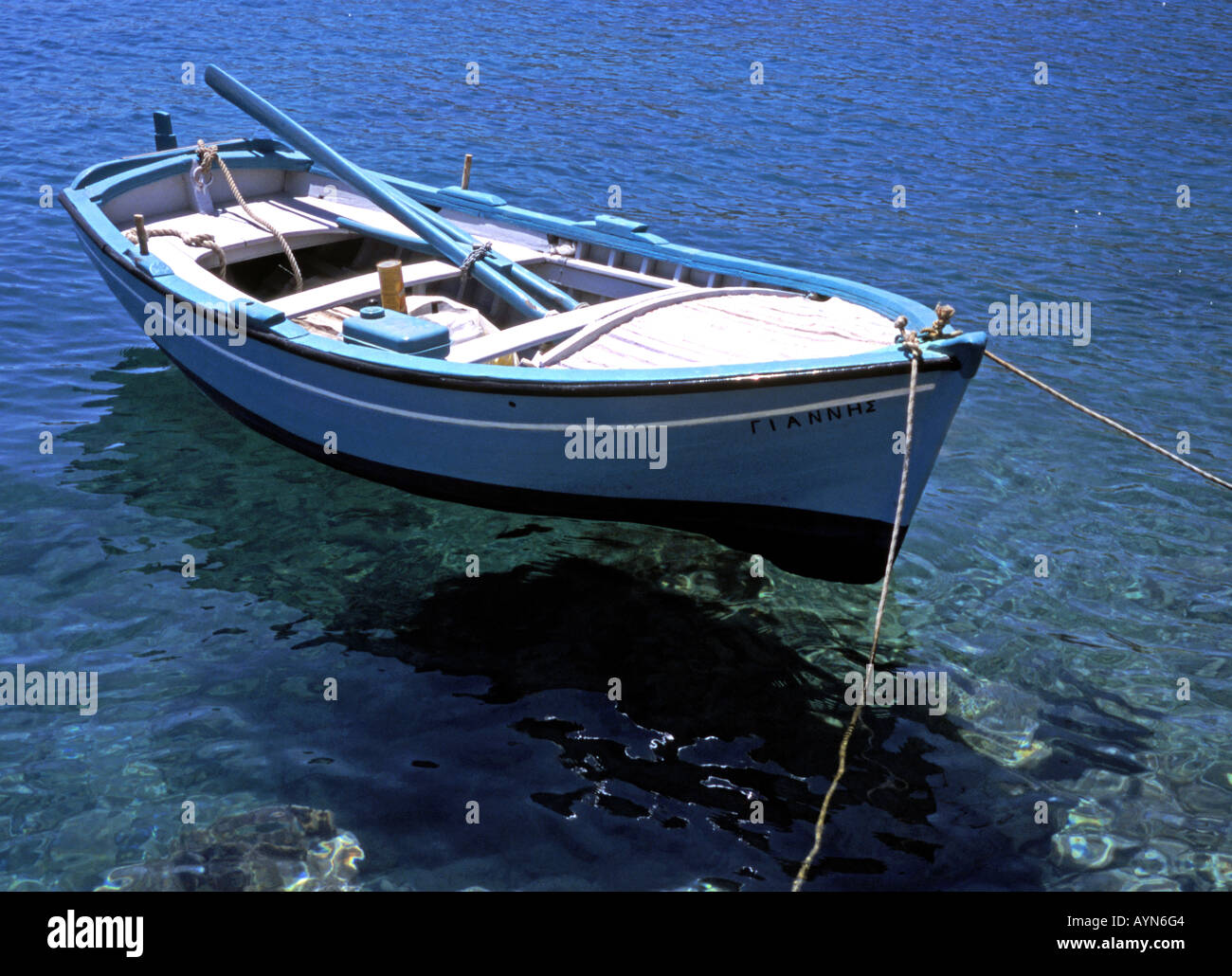 Rowing boat on the blue sea - Stock Image