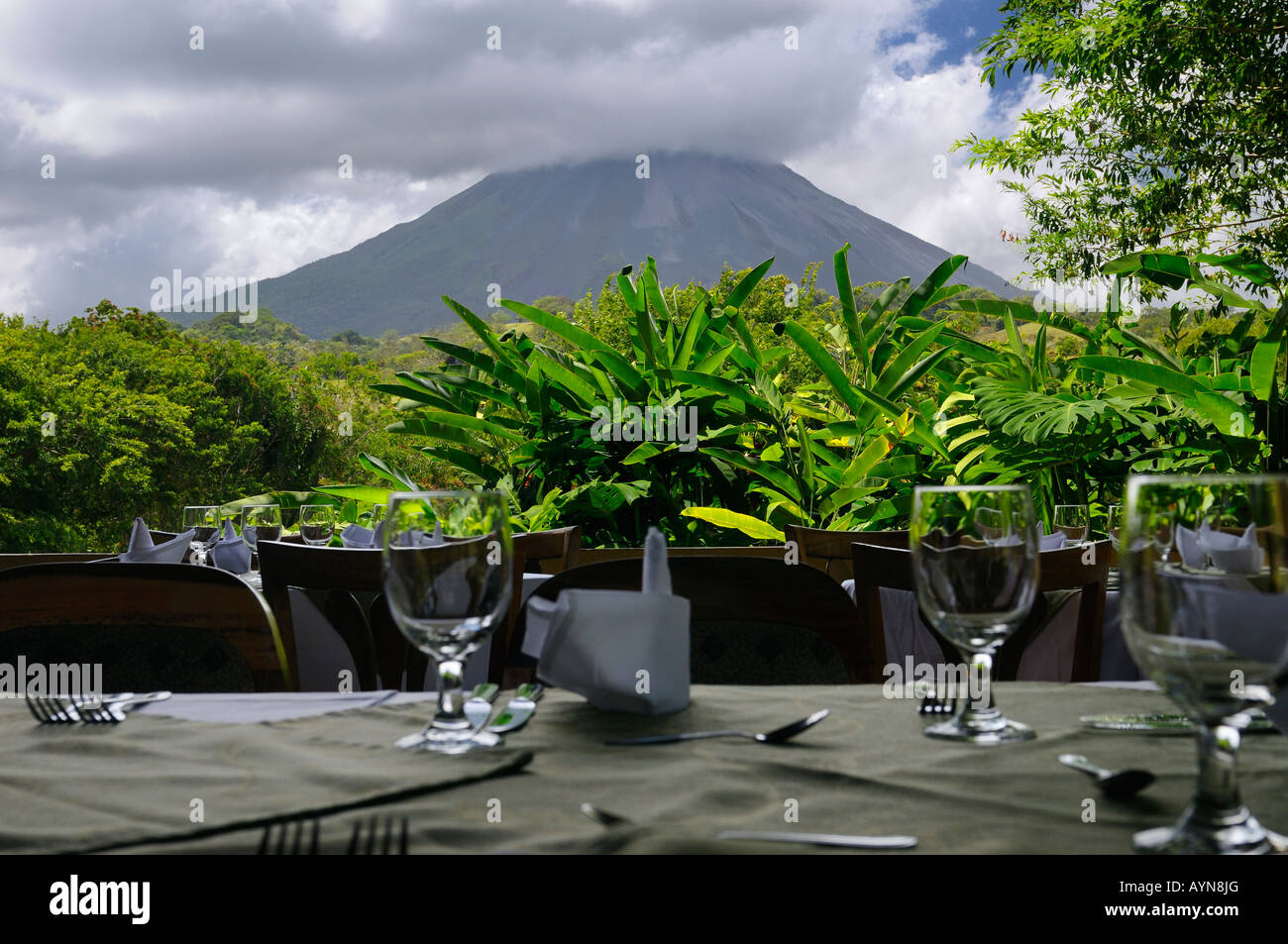 View of Arenal Volcano from the Paraiso Resort restaurant tables - Stock Image