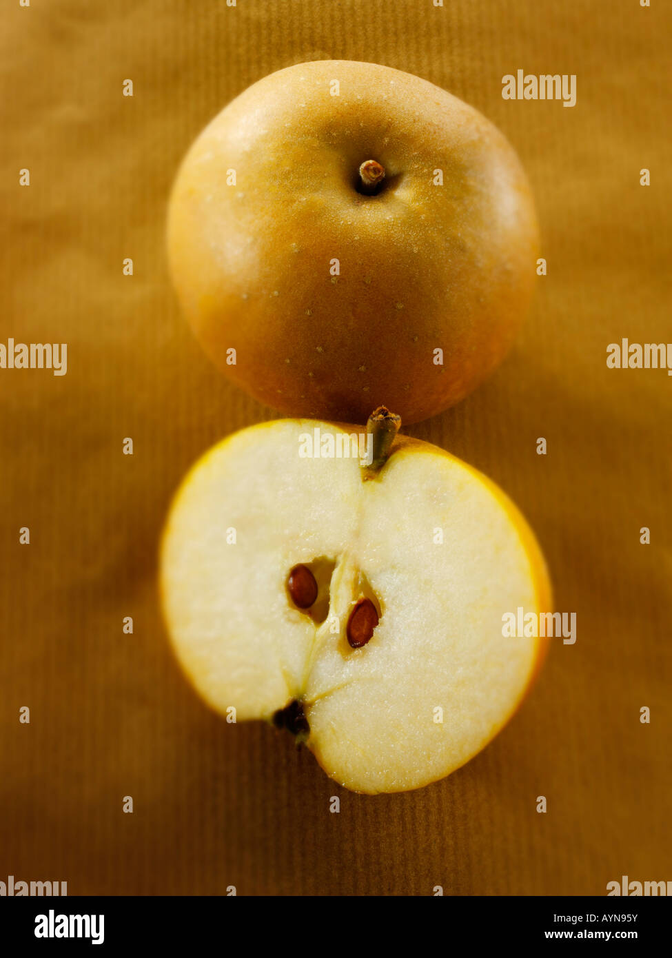 Organic Russet apple cut and whole - Soft Focus - Stock Image