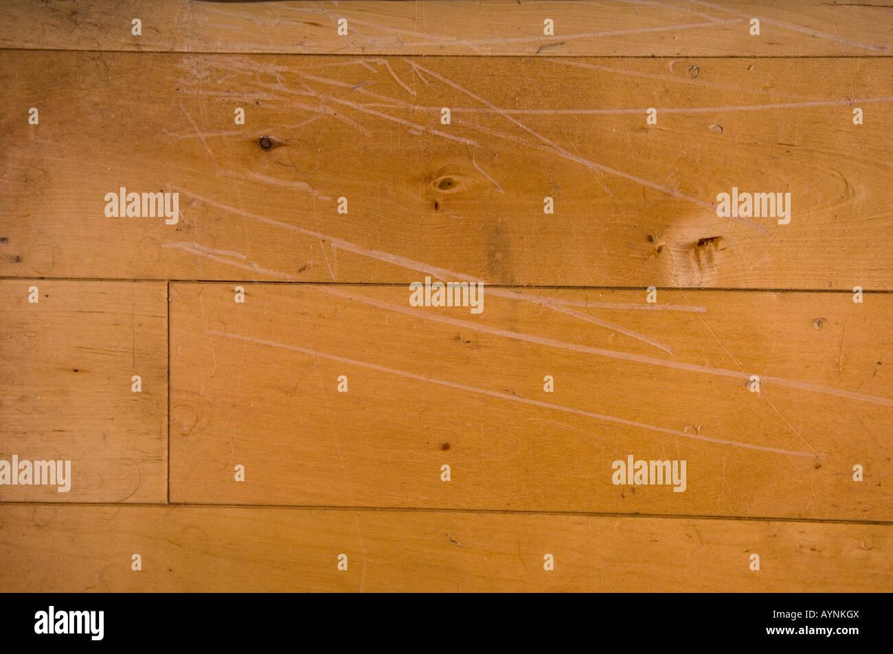 Close up of damaged laminated wooden flooring - Stock Image