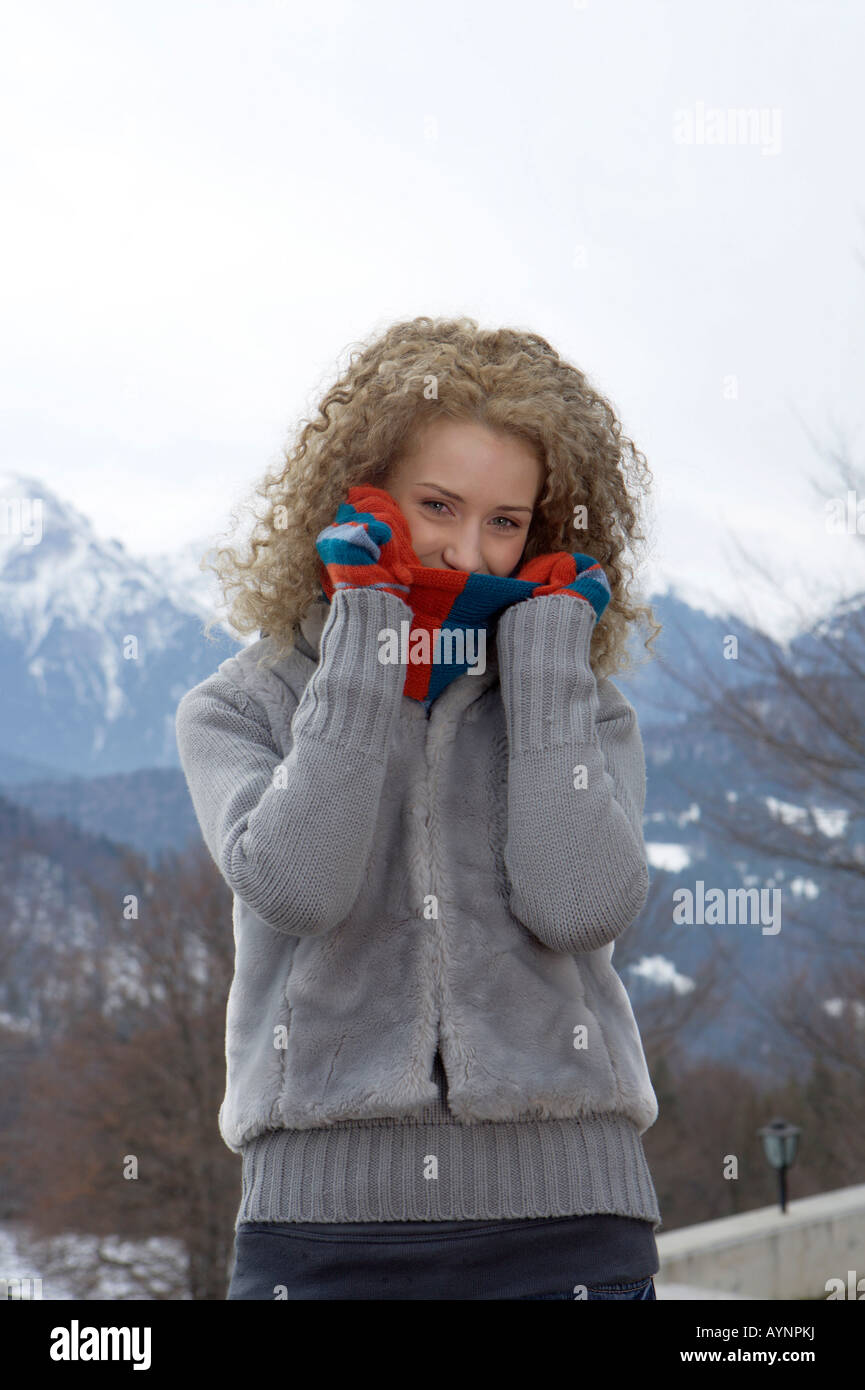 Young blonde woman in a winterly landscape, close-up - Stock Image
