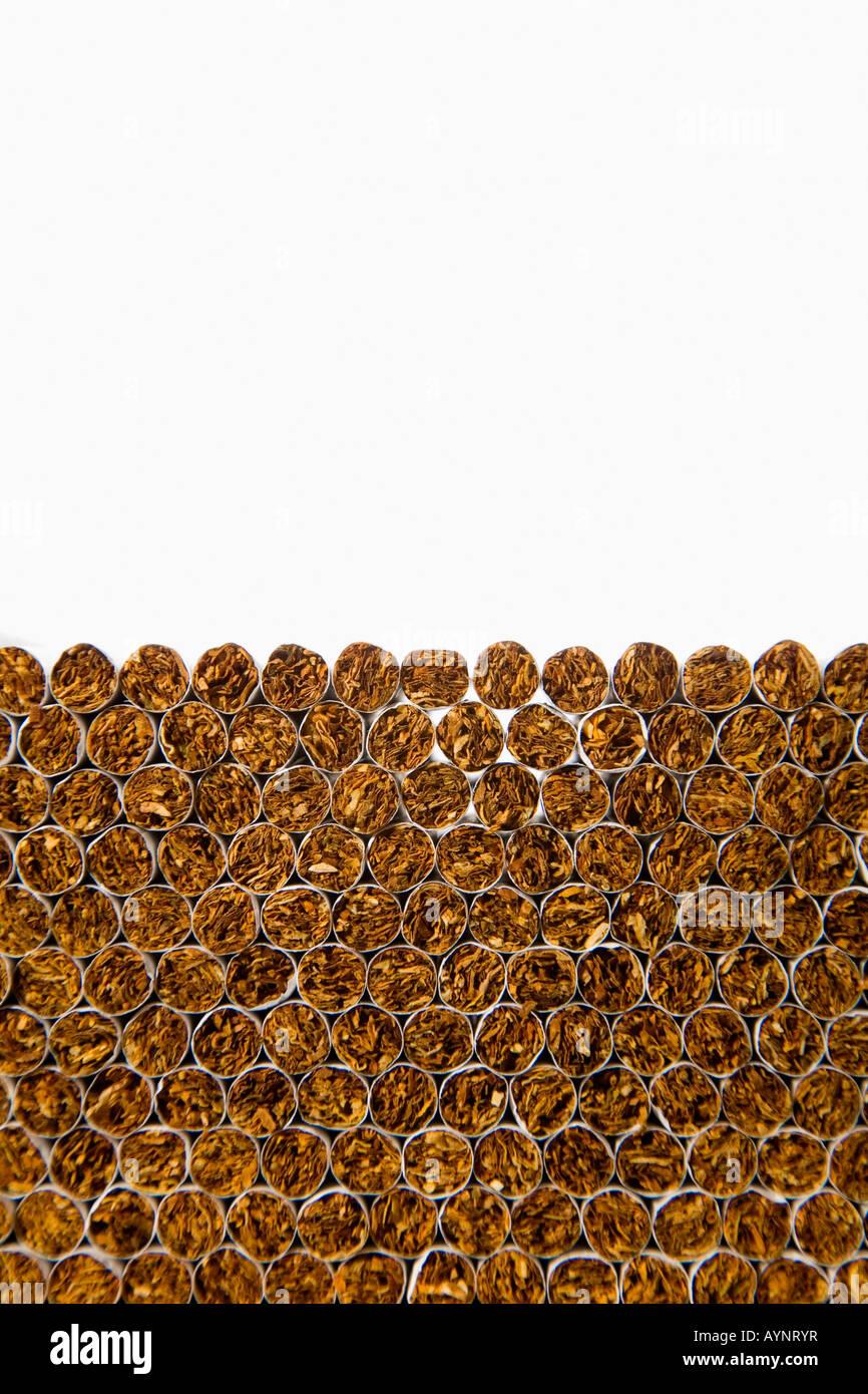 Piled up cigarettes - Stock Image