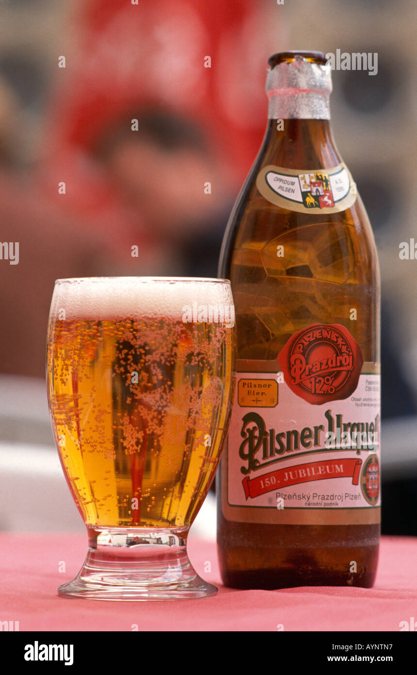 A glass and bottle of Pilsner Urquell lager produced in Plzen in the