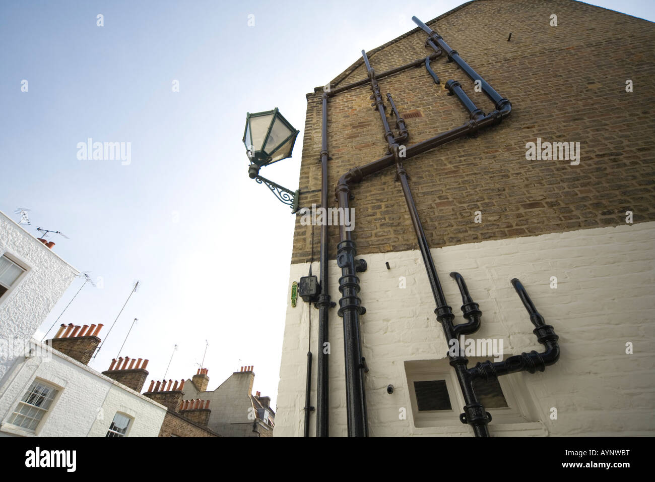 External plumbing guttering and pipework Chelsea London SW3 - Stock Image