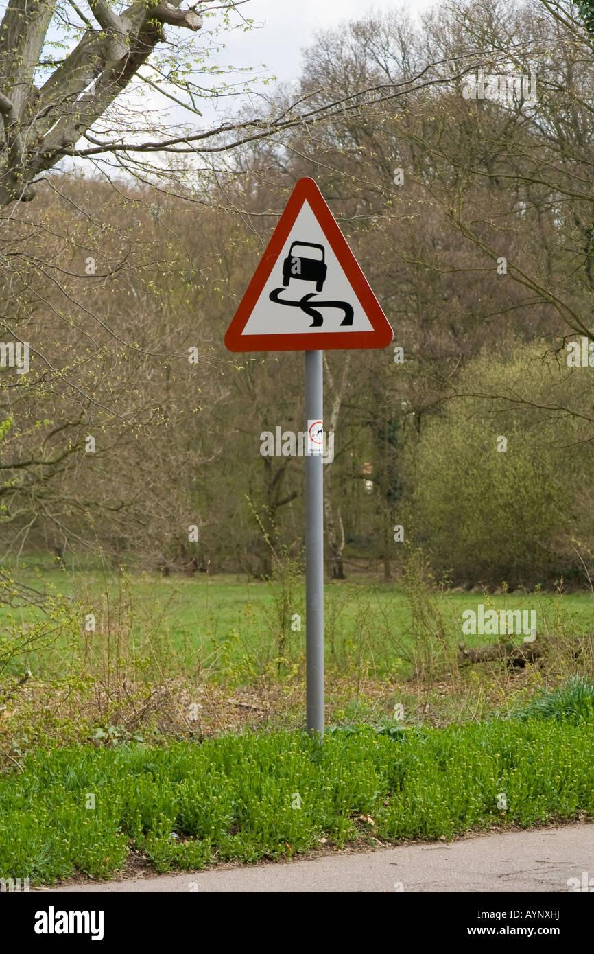 Slippery Road sign, UK. - Stock Image