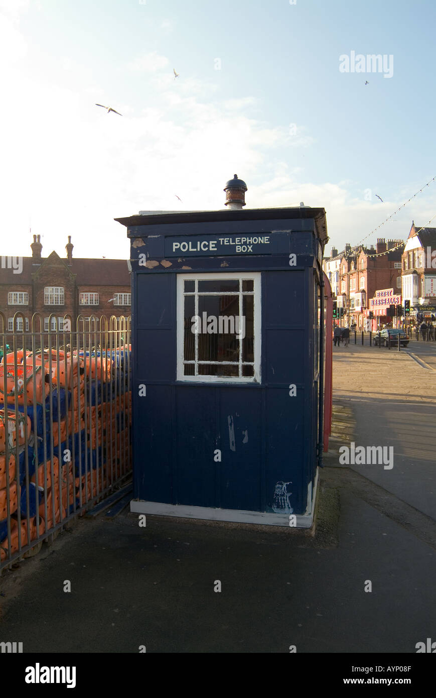 police phone box on seafront at scarborough seaside town in north yorkshire england dr who tardis blue flashing light    doctor - Stock Image