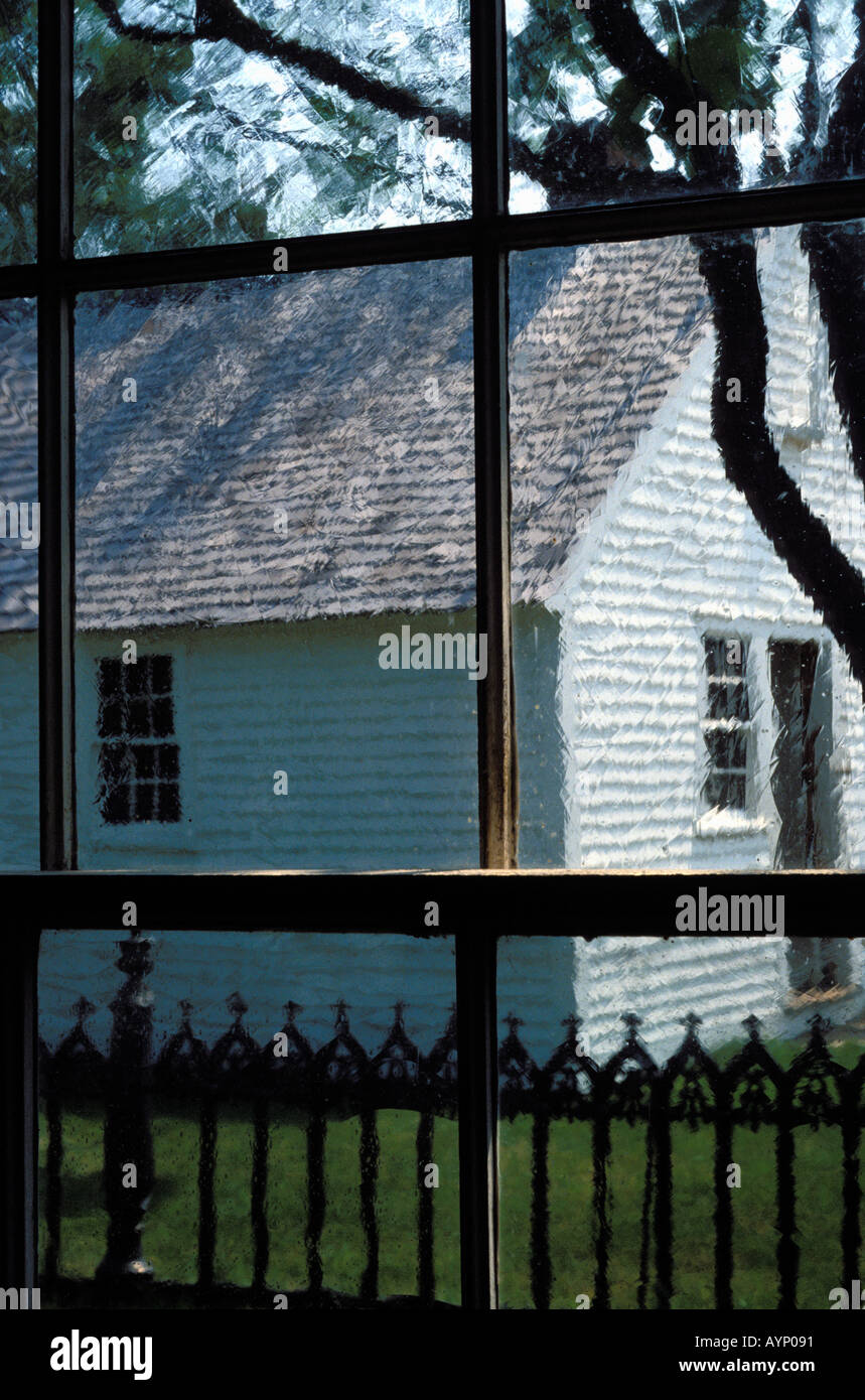 The restored Tapping Reeve law school in Litchfield Connecticut seen through antique glass window panes - Stock Image