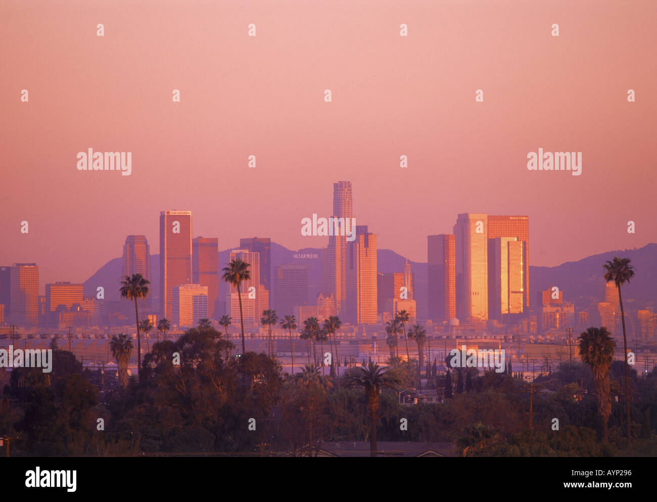 Sunrise Hitting Downtown Los Angeles Skyline And Hollywood Sign