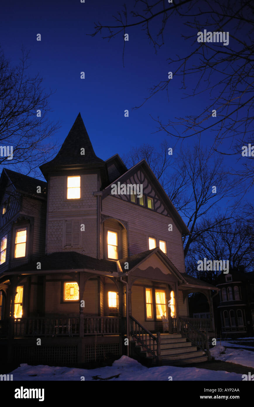 An Old Haunted Victorian House Lit up at Night - Stock Image