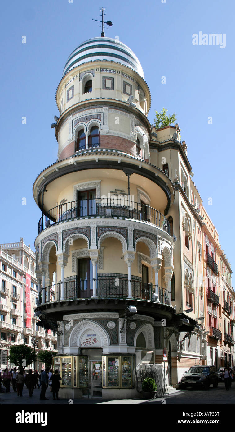 Famous round building with the Filella Confiteria shop. Seville Spain. - Stock Image