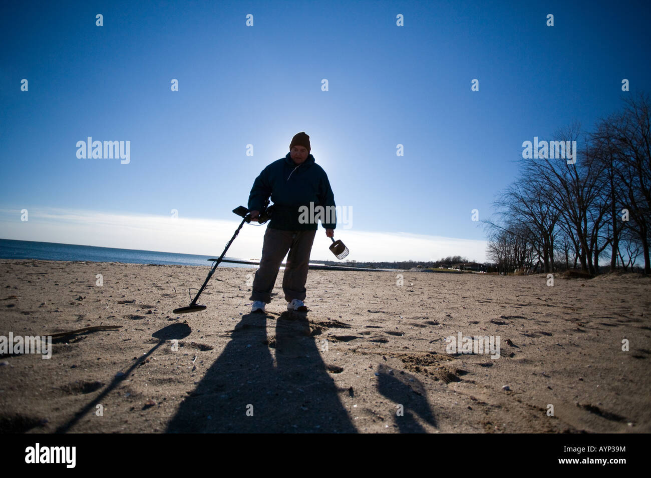 Jew Detector: Man Using A Metal Detector On A Beach In West Haven