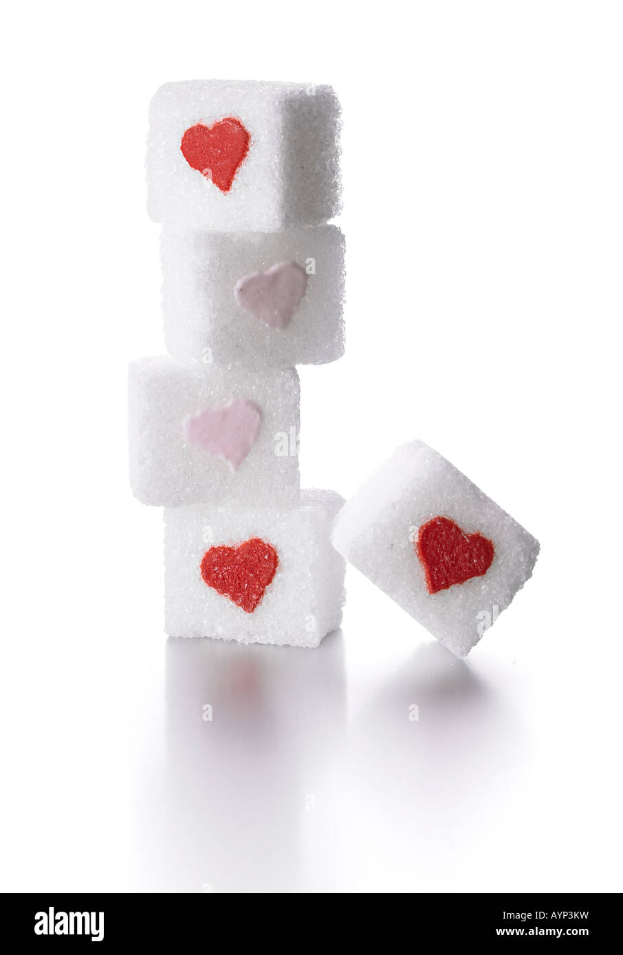 sugar cubes with red hearts - Stock Image
