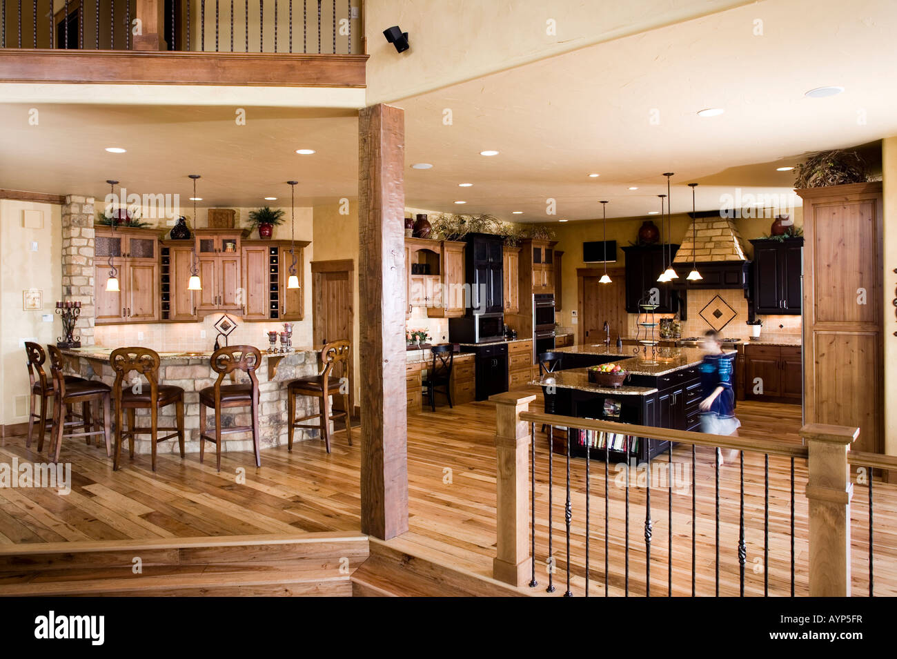 Luxury home interior spacious kitchen 'wood floors' 'breakfast bar' in Fort Collins, Colorado. - Stock Image