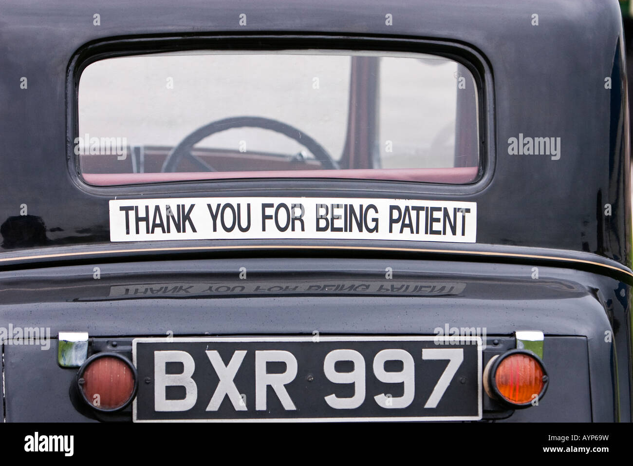 Thank you for being patient\' sticker on rear of classic car Stock ...