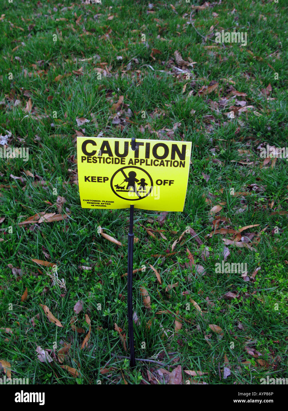 Pesticide warning on lawn, Washington DC, USA - Stock Image