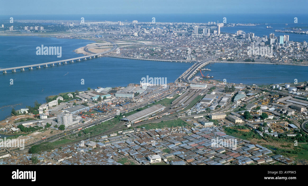 NIGERIA West Africa Lagos Cityscape Skyline Aerial view of the Capital City and road bridges - Stock Image