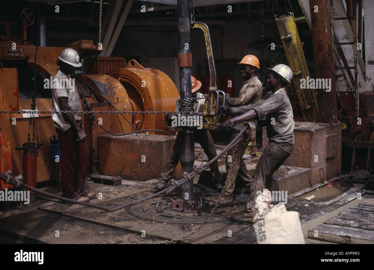 NIGERIA West Africa Rivers State Industry Workers on oil rig drilling platform - Stock Image