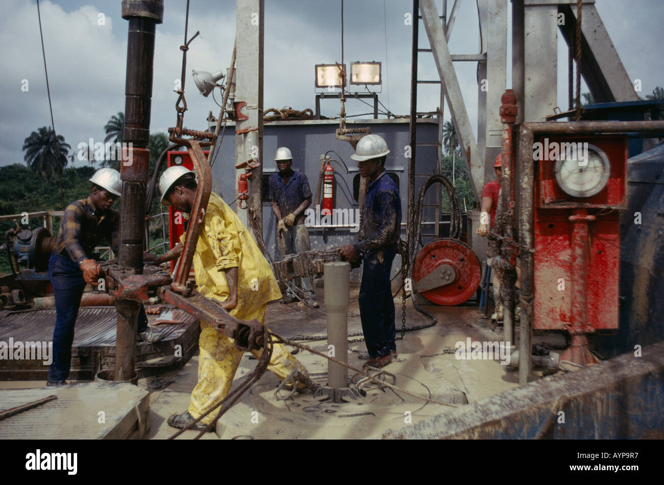 NIGERIA West Africa Rivers State Industry Workers on Shell oil rig drilling platform - Stock Image