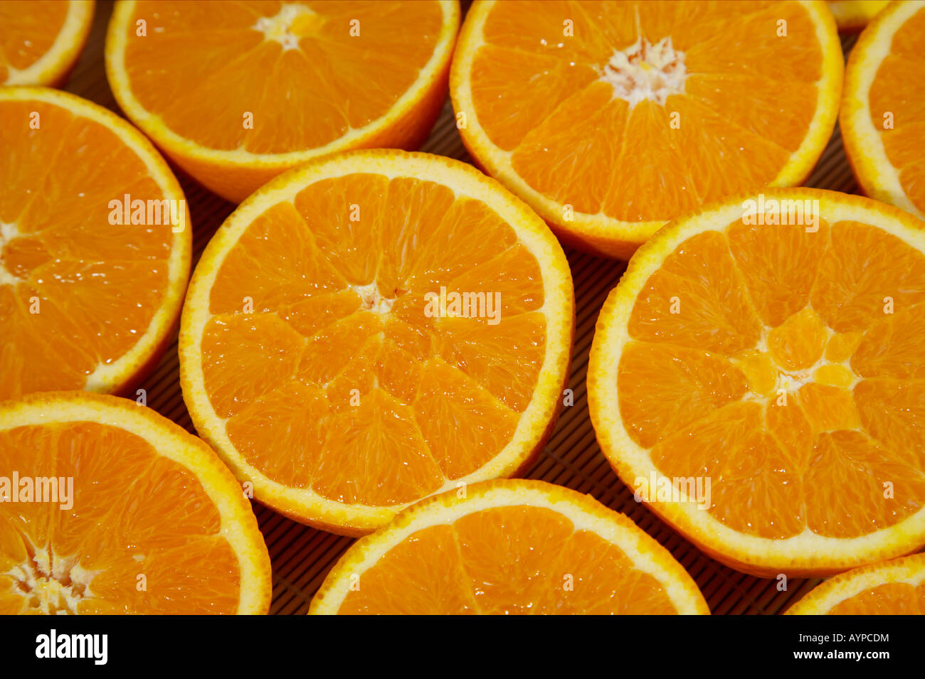 Halved oranges - Stock Image