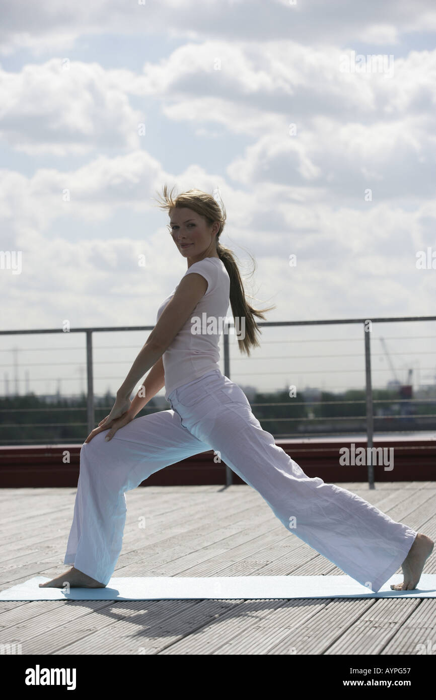 A blonde woman exercising Stock Photo