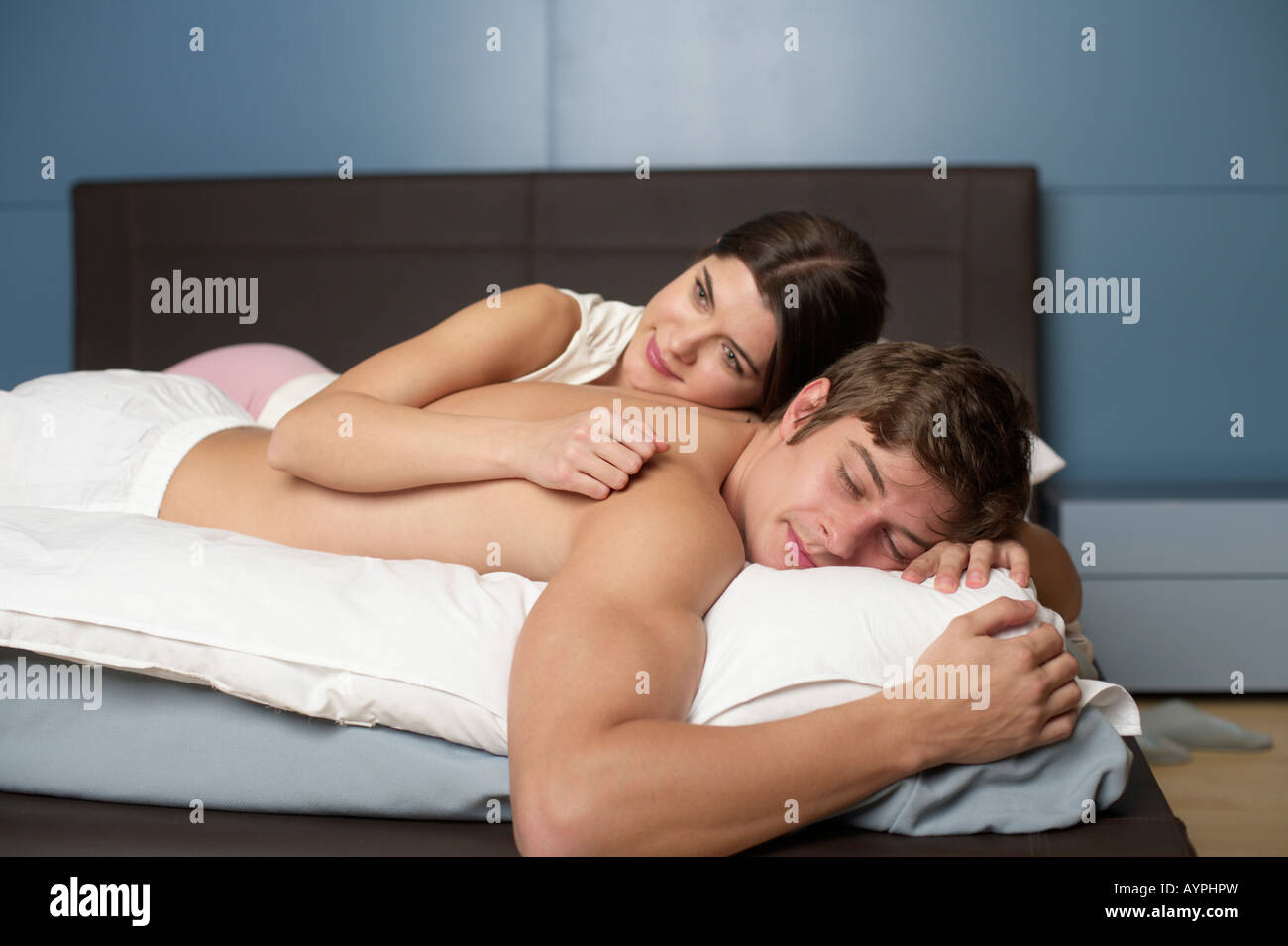 Young couple in bed, selective focus - Stock Image