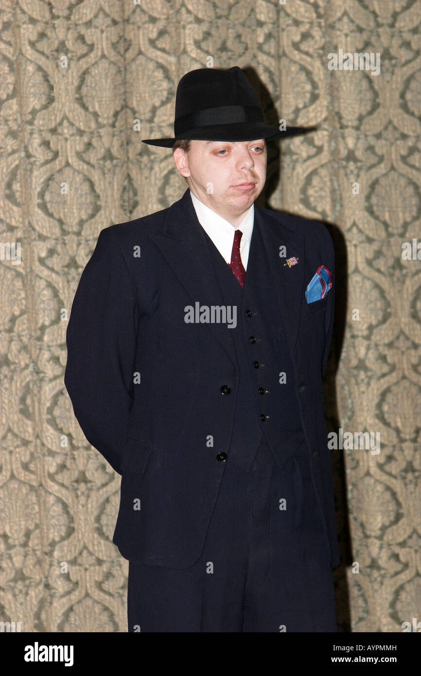 Man dressed as 1940s  spiv  in suit and trilby Stock Photo  17160880 ... 6cfddb04885