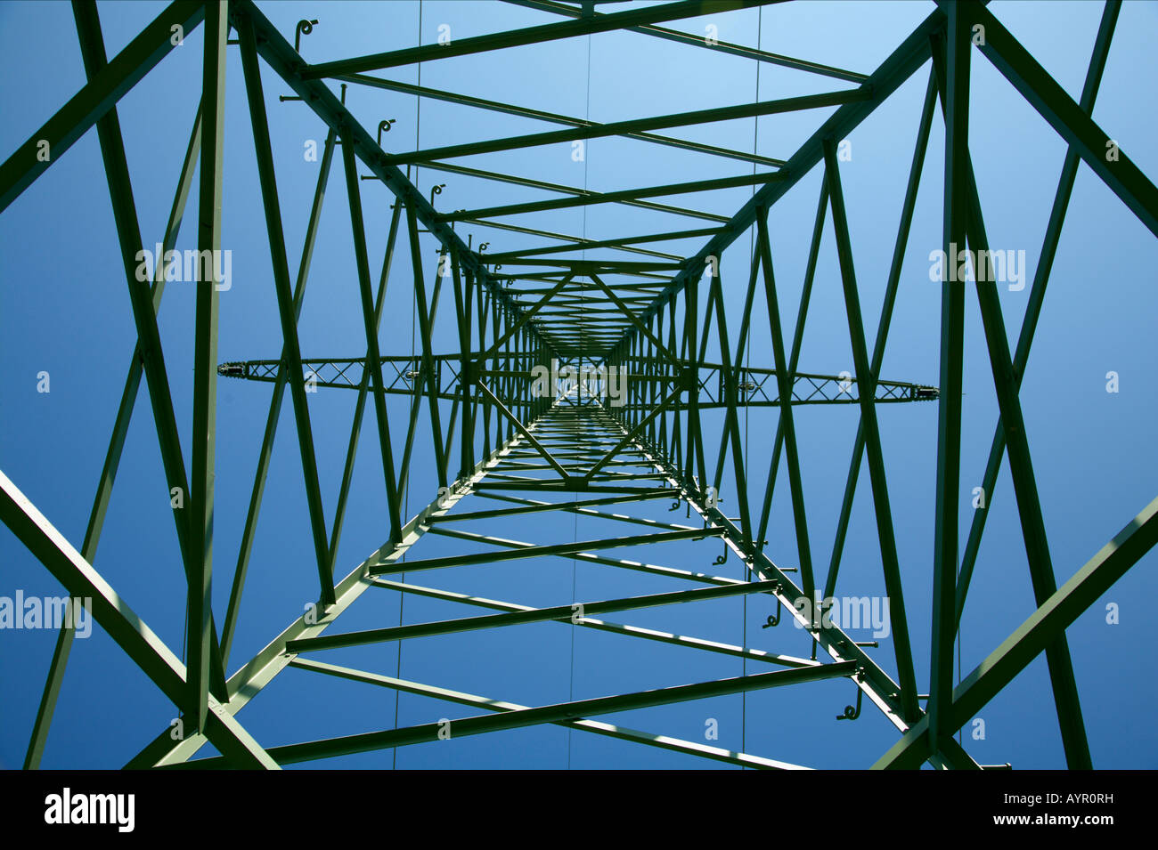 Low angle view inside a power line tower - Stock Image