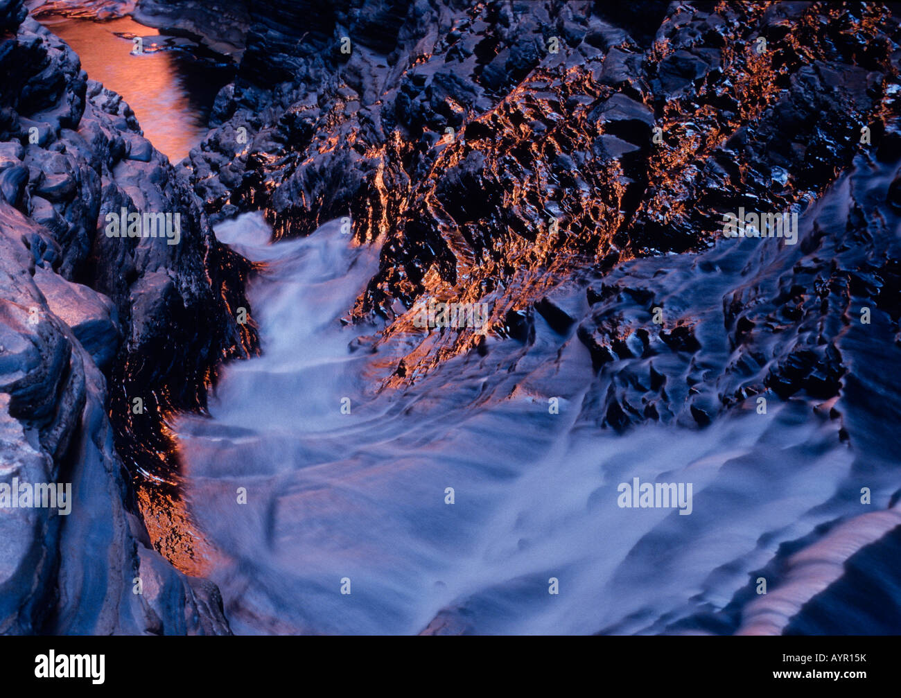 Fast-flowing stream (torrent), Hancock Gorge, Karijini National Park, Pilbara Region, Western Australia, Australia - Stock Image