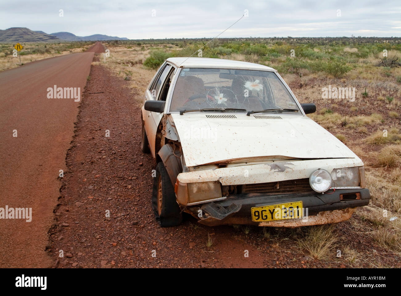 Car wrecked after a collision with a kangaroo parked on the shoulder of a highway in Western Australia, Australia - Stock Image