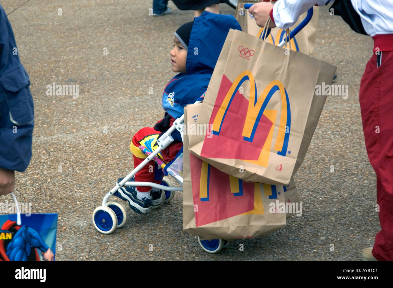 CHILD IN PUSH CHAIR WITH MC DONALD S CARRIER BAGS CHICAGO