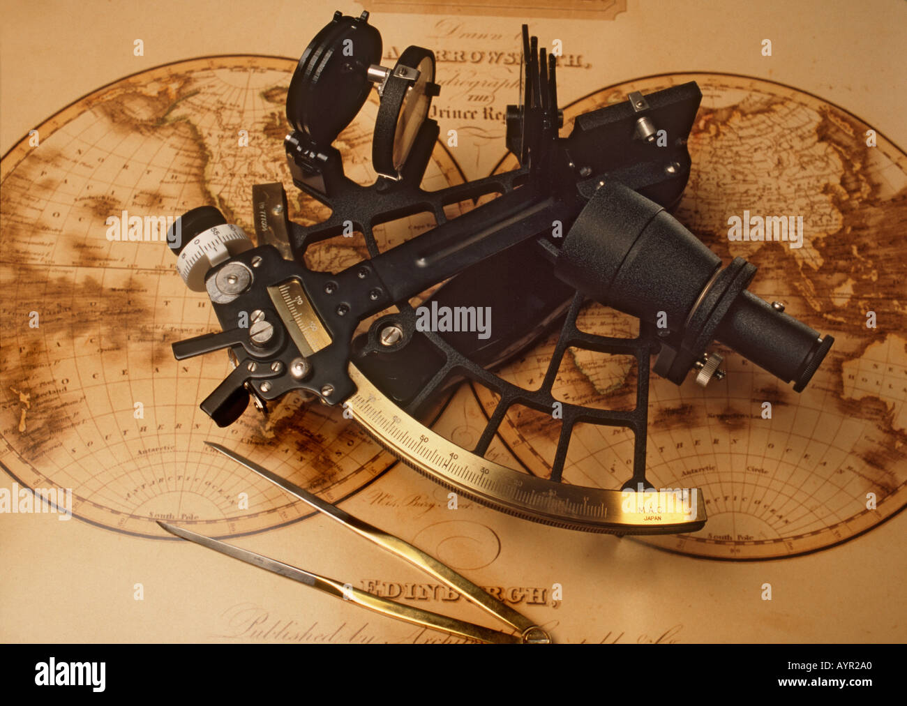 Sextant And Dividers On Antique Nautical Chart Stock Photo