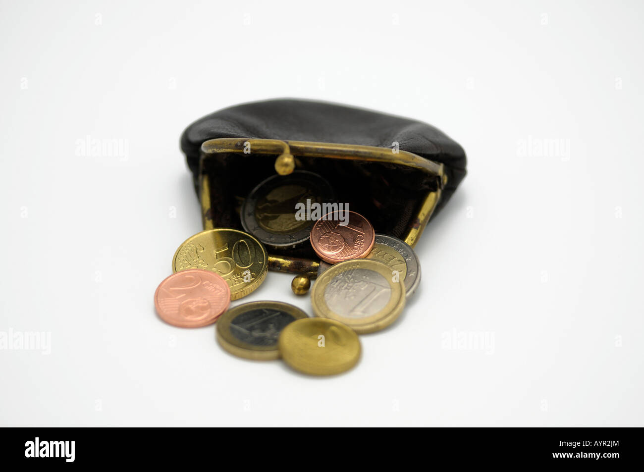 Euro coins falling out of a change purse - Stock Image