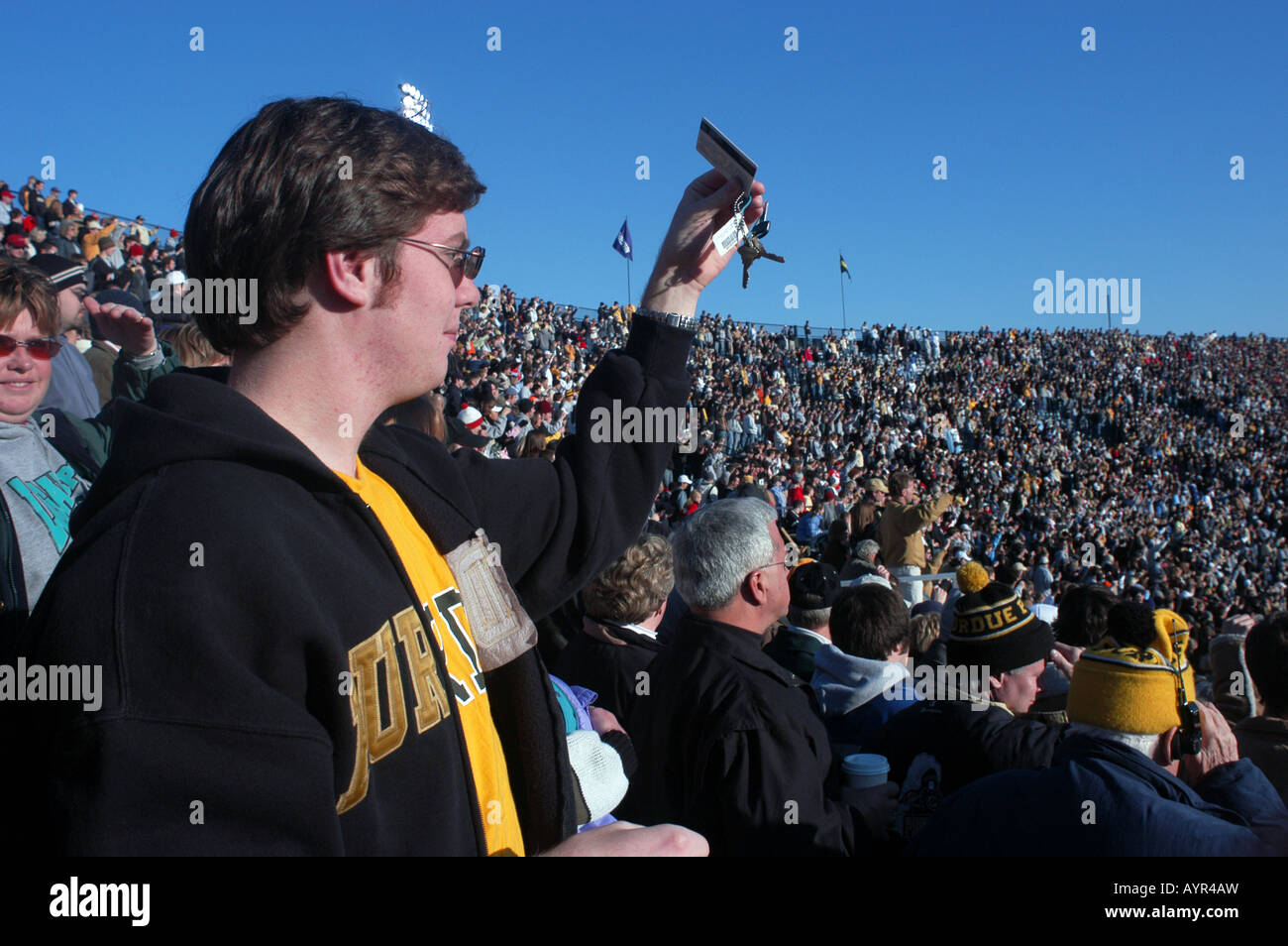 College student cheers at Purdue University football game crowd jingles keys in cheer West LaFayette Indiana USA - Stock Image