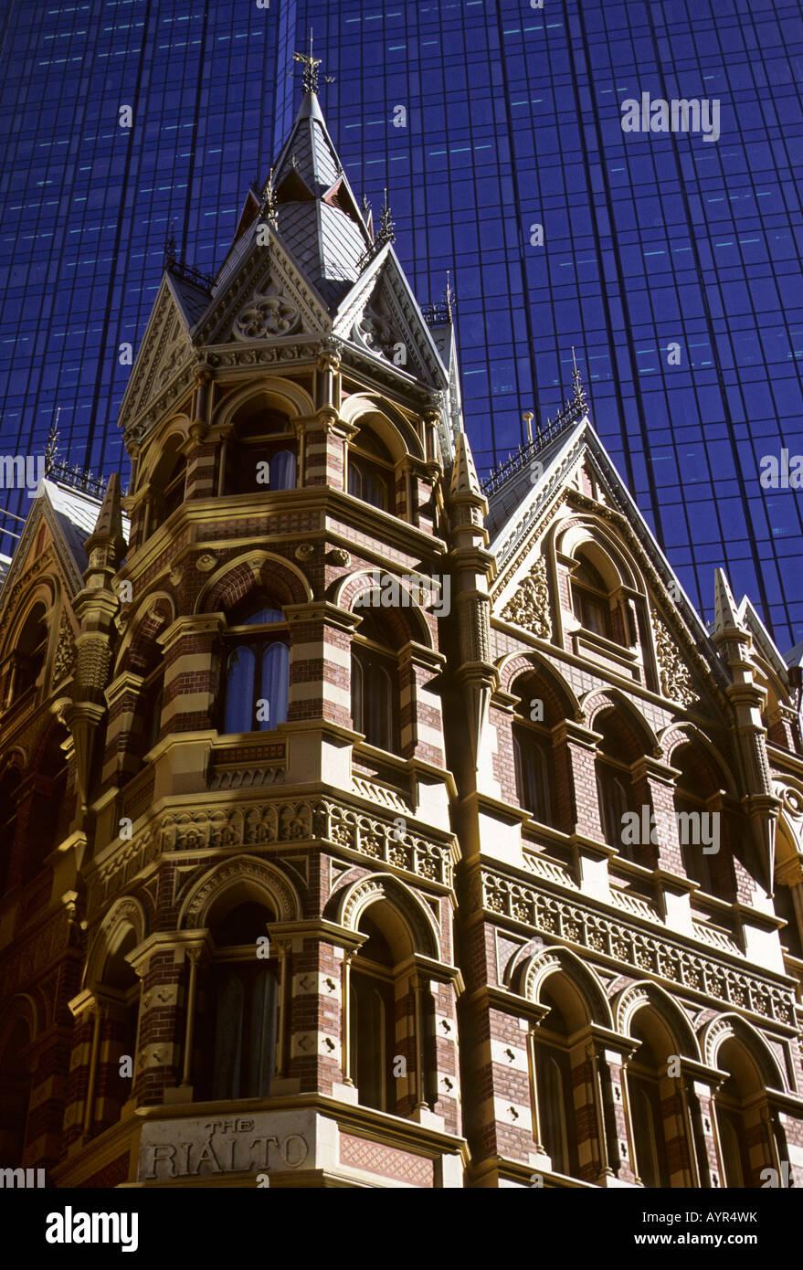The Rialto Hotel in front of the glass facade of the Rialto Towers in Melbourne, Victoria, Australia Stock Photo