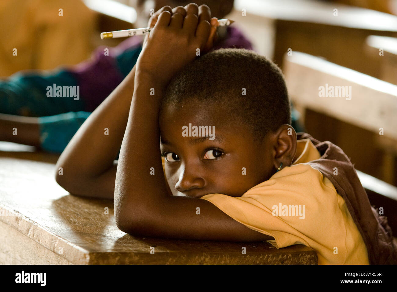 Girl attends class at the Nyologu Primary School in the village of Nyologu northern Ghana - Stock Image
