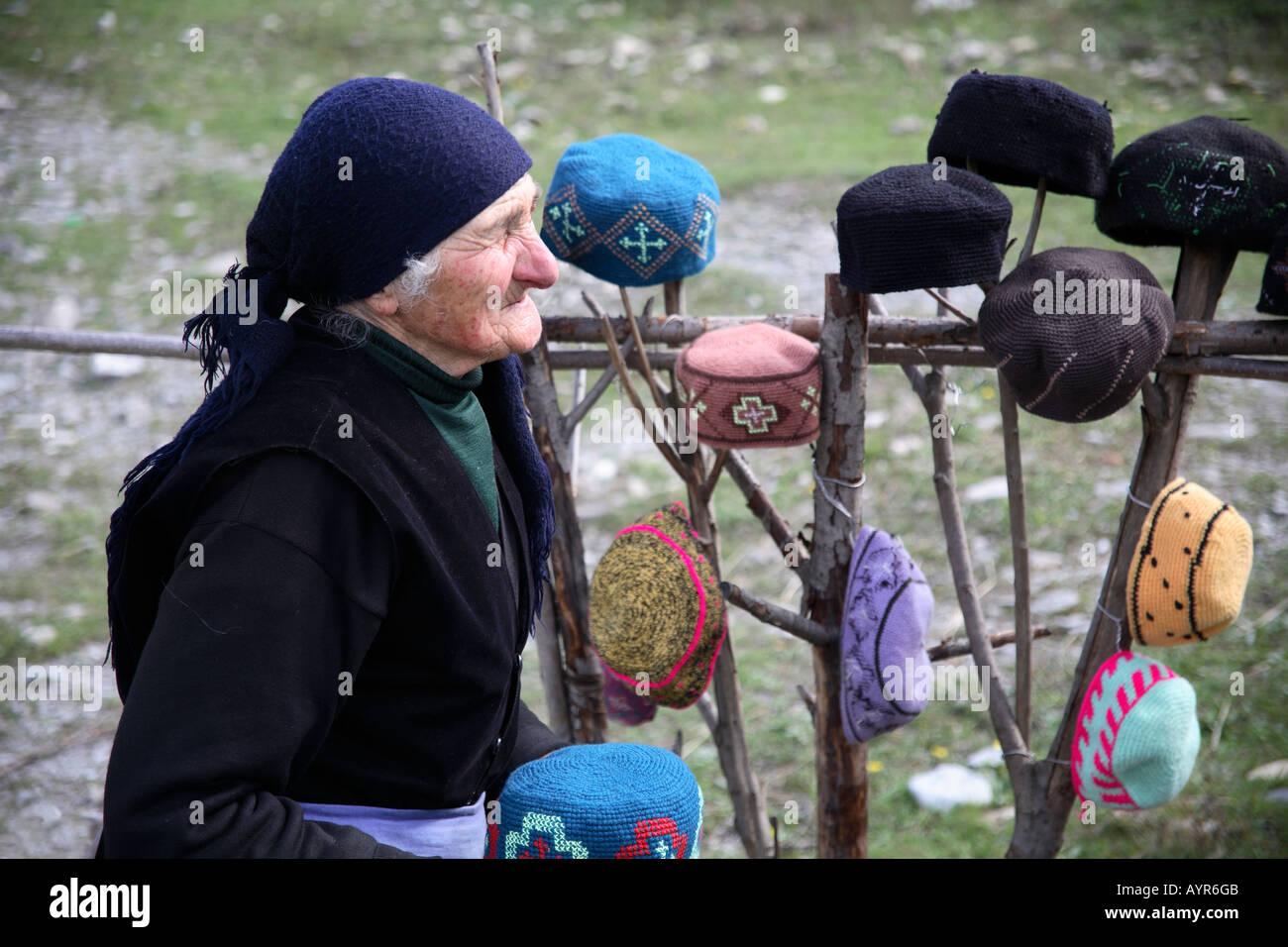 Roadside hat seller. Jvari Pass, Georgian Military Highway, Georgia, Southwest Asia - Stock Image