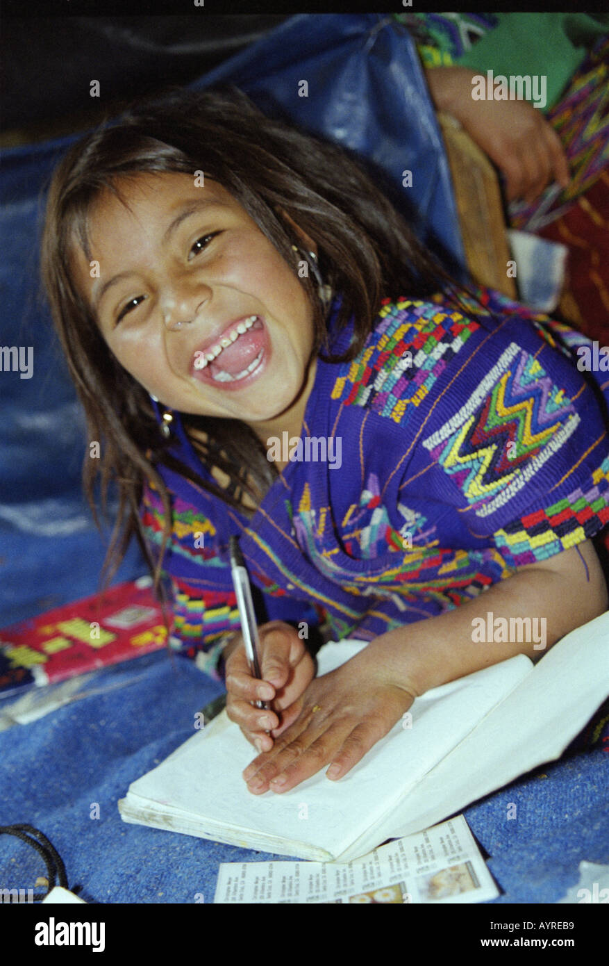 July 1997 Maya Ixil girl does homework in village of Chajul in north of Ixil triangle El Quiche Guatemala James Sturcke - Stock Image