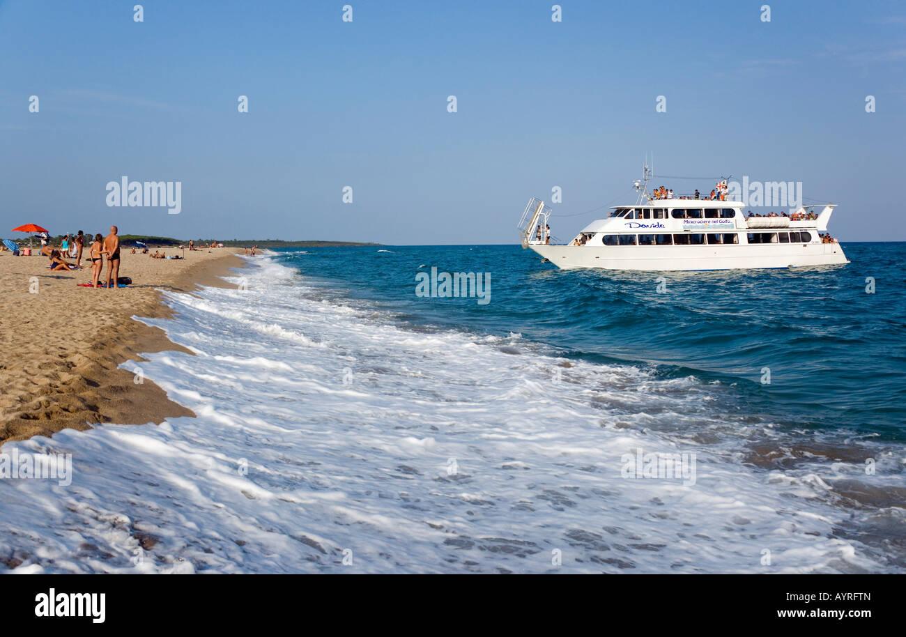 Charter boat coming in to Marina di Orosei near Orosei, Sardinia, Italy - Stock Image