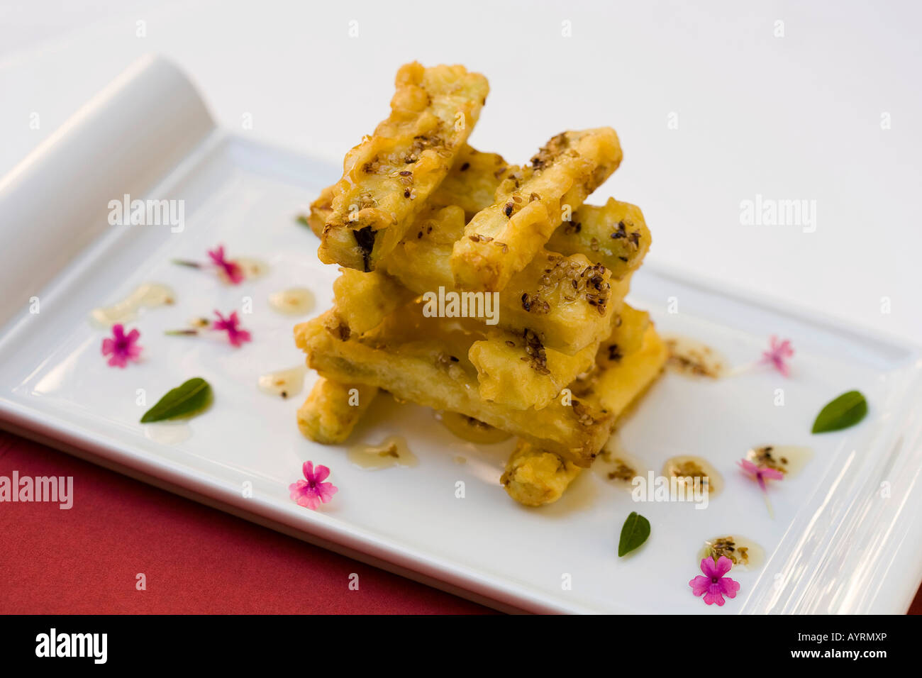 Eggplant with avocado honey and sesame seeds served at the Parador Hotel restaurant, Granada, Andalusia, Spain, Stock Photo
