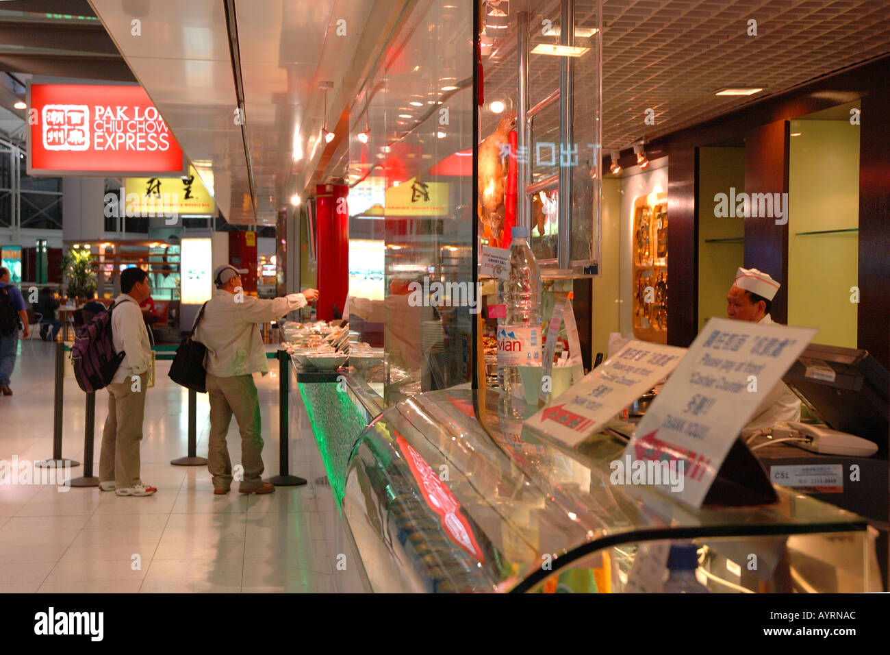 Fast food counter at Hong Kong's International Airport - Stock Image