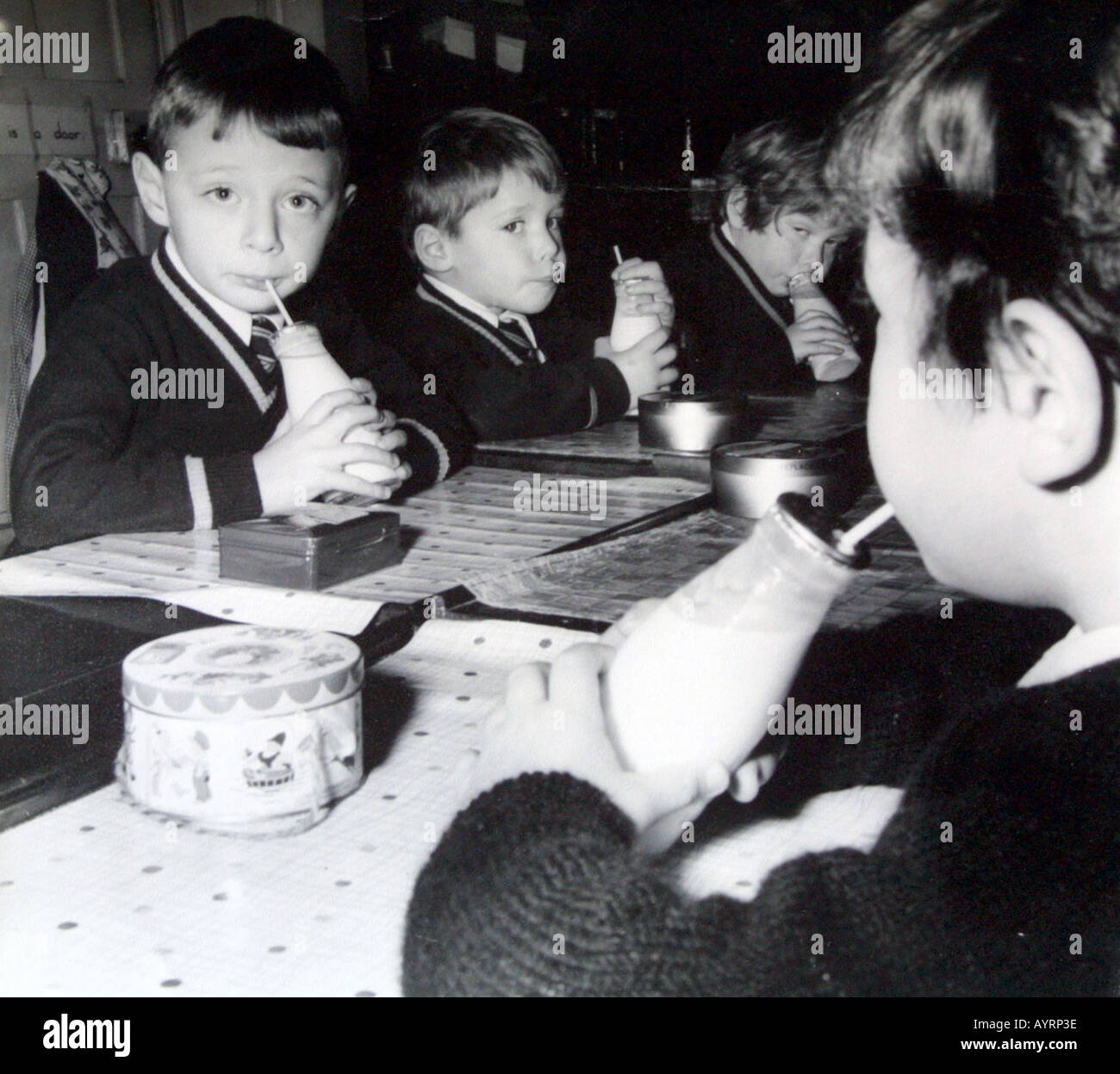 prmary school children having a free milk break in 1959 - Stock Image